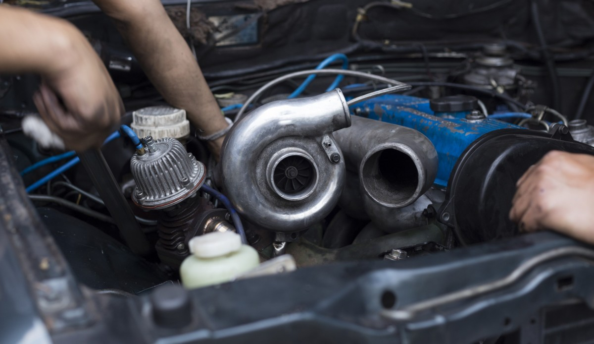 turbocharger under hood of car